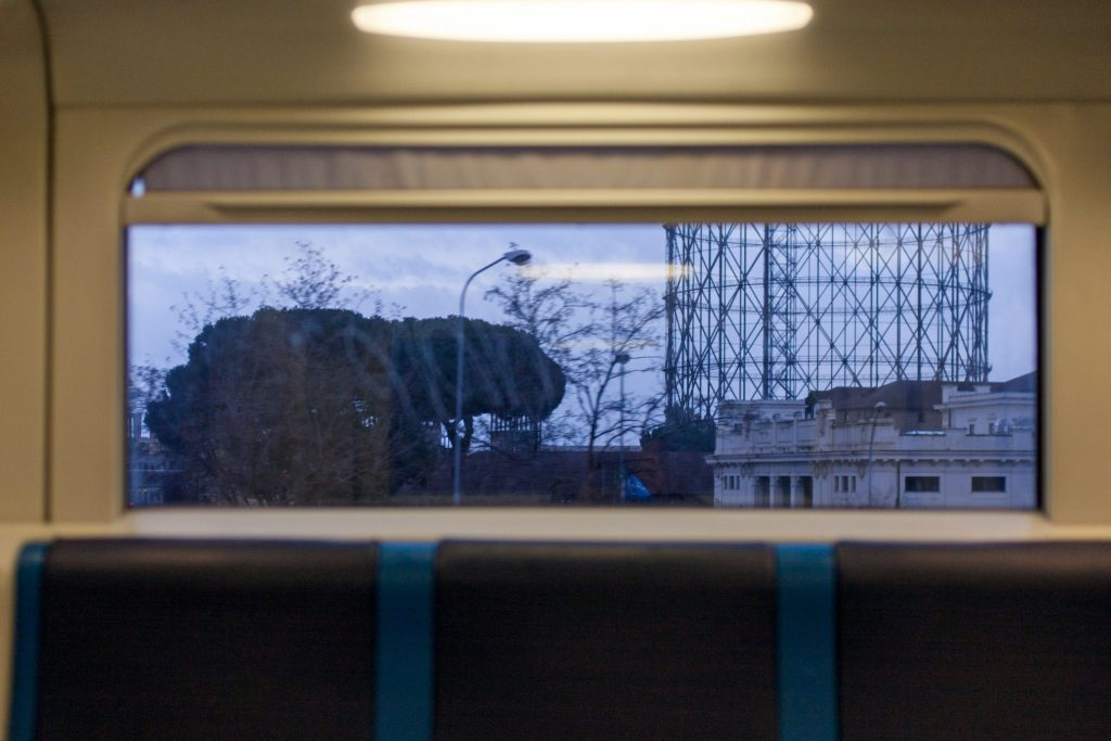 gasometer train window testaccio photo by gabriele gelsi